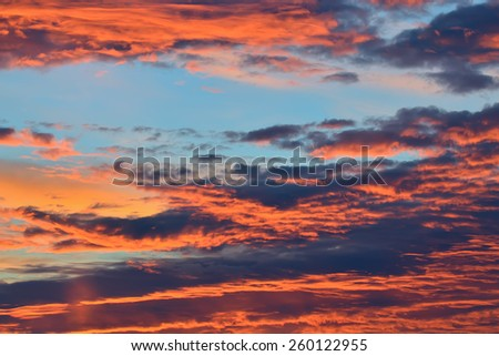 Heavenly landscape with dramatic crimson clouds - stock photo