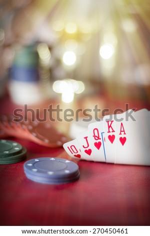 Heavenly light illuminates a winning hand in this poker background photo - stock photo