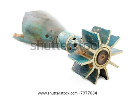 heavily damaged battle torpedo with tail fins - rear view - stock photo
