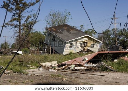 Heavily damaged homes in the Ninth Ward of New Orleans. .Behind these homes is the industrial canal the one that collapsed during the storm surge of hurricane Katrina. - stock photo