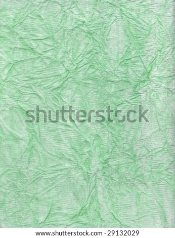 Heavily textured green paper surface. - stock photo