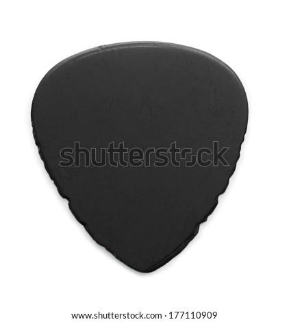 heavily worn and used black guitar pick, isolated on white. Sides have notches from heavy string sliding. - stock photo