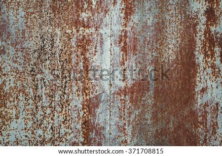 Heavily worn red peeled rusty wall.  - stock photo