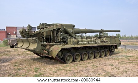 Heavy army self-propelled unit with a gun. Firing range of 30-35 km. Armored Army equipment. - stock photo