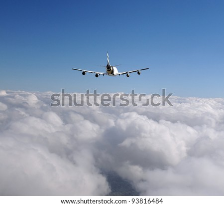 Heavy cargo jet flying at high altitude - stock photo