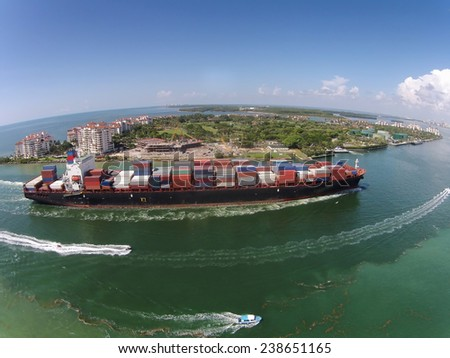 Heavy cargo ship enters the Port of Miami aerial view
