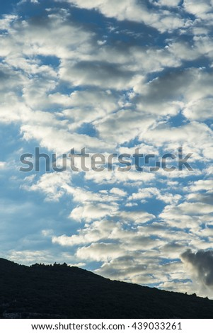 Heavy clouded skies over a steep slope