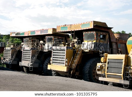 Heavy coal dumpers in a opencast mine - stock photo