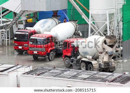 Heavy Concrete Truck on Construction Site - stock photo