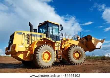 heavy construction loader bulldozer at construction area - stock photo