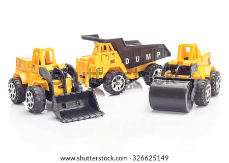 Heavy Construction Machinery Toy on white background.