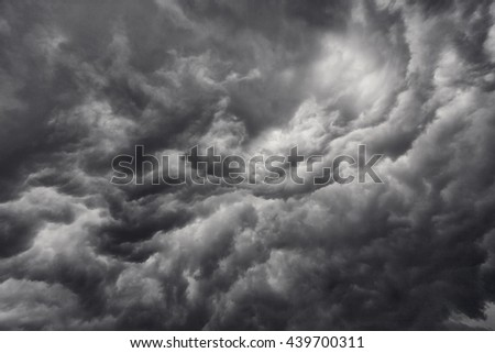 Heavy dark clouds before the storm. - stock photo