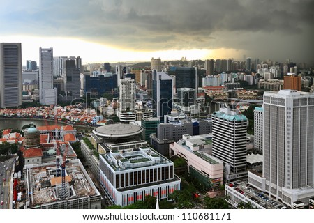 Heavy dark clouds  over the skyline of Singapore. - stock photo