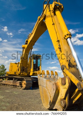 Heavy Duty Construction Equipment Parked at Worksite - stock photo
