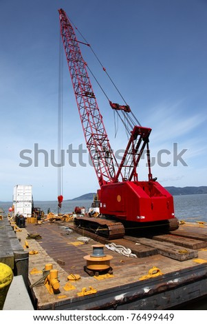 Heavy duty crane on a barge, port of Astoria OR. - stock photo