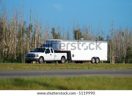 Heavy duty pickup truck and trailer - stock photo