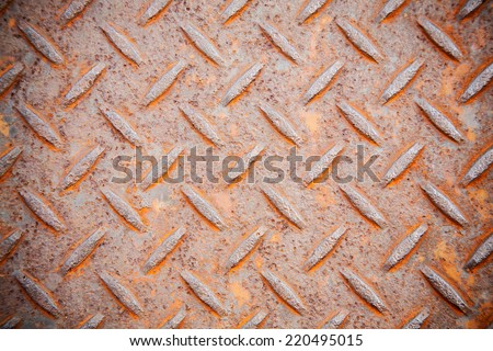 heavy duty rusty metal background with non slip repetitive patten. Concept image for urbanization, steampunk, construction, safety at work, oxidation. - stock photo