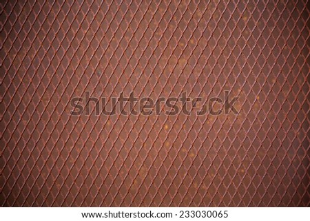 heavy duty rusty metal background with non slip repetitive patten. Concept image for urbanization, steampunk, construction, safety at work, oxidation.