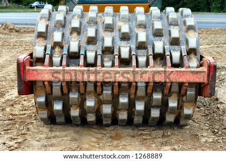 Heavy end of an earth compactor - stock photo