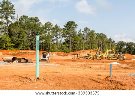 Heavy equipment in graded new residential construction site - stock photo