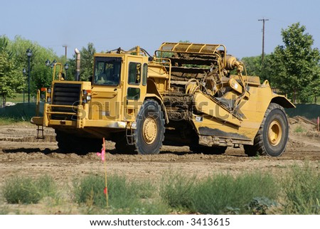 Heavy equipment spreads soil on a construction project