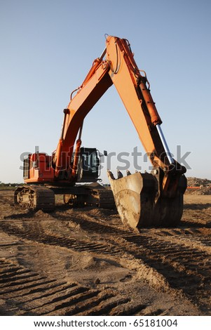 Heavy excavating equipment at a construction site.