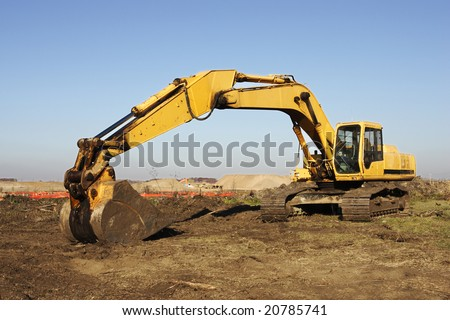 Heavy excavation equipment at a large construction site.