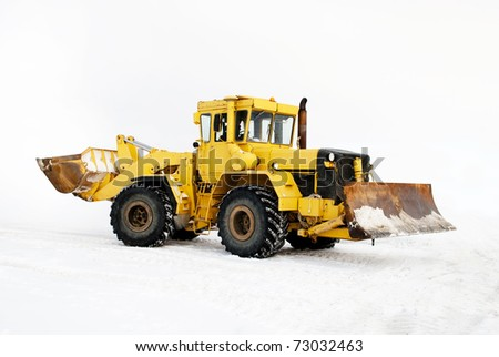 heavy excavator on snow - stock photo