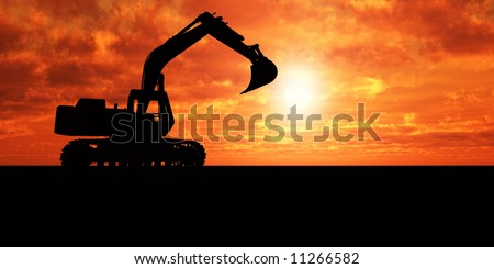 Heavy excavator over orange background - stock photo