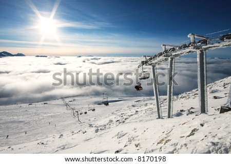 Heavy fog covers the lower mountain while the alpine is bathed in glorious sunshine in Whistler, BC, site of the 2010 winter Olympic Games. - stock photo