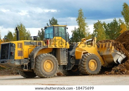 heavy front loader in work - stock photo