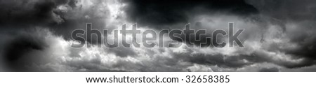 heavy gale black stormy clouds. panorama - stock photo