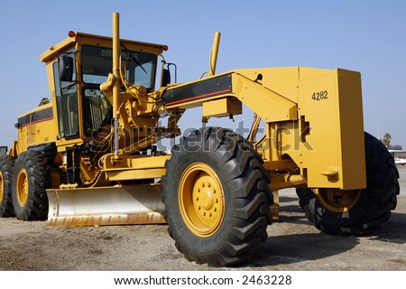 Heavy grading equipment on construction job site