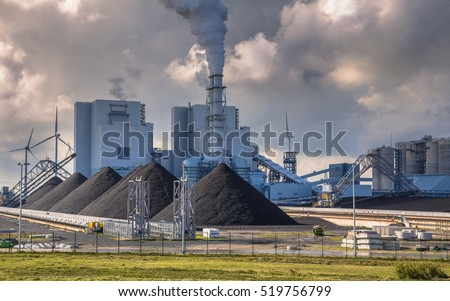 Heavy industrial coal powered electricity plant with pipes and smoke in black and white