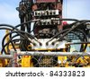 heavy industrial machinery with hoses - stock photo