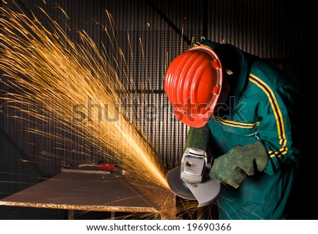 heavy industry manual worker with grinder background - stock photo