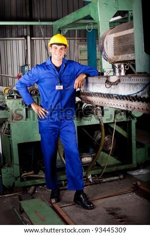 heavy industry mechanic portrait in factory - stock photo
