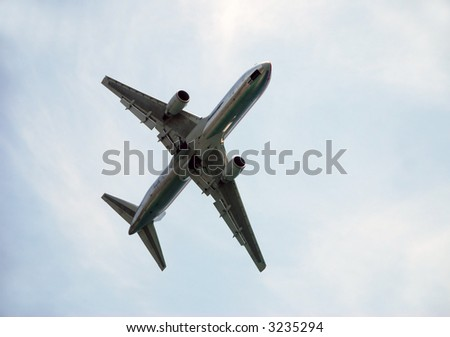 Heavy jet passing overhead - stock photo