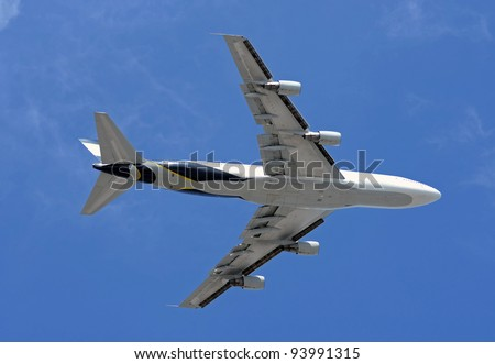 Heavy jumbo jet seen from below - stock photo