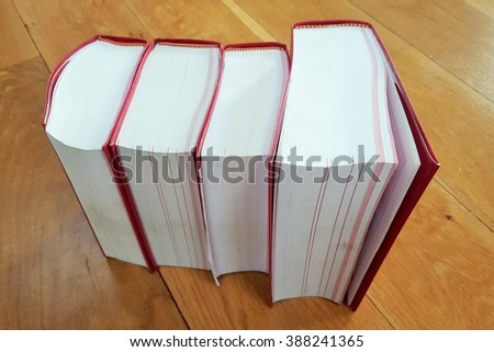 Heavy law books and codes on a wood floor - stock photo