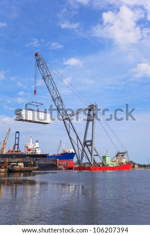 Heavy lifting floating crane vessel during operation.