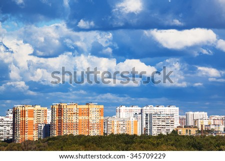heavy low blue clouds over modern urban houses in summer