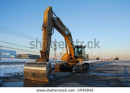 Heavy machinery at sunset - stock photo