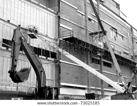 heavy machinery at work in a construction site. - stock photo