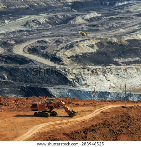 Heavy machinery Digging for coal Mae Moh mine in Lampang at Viewpoint. - stock photo