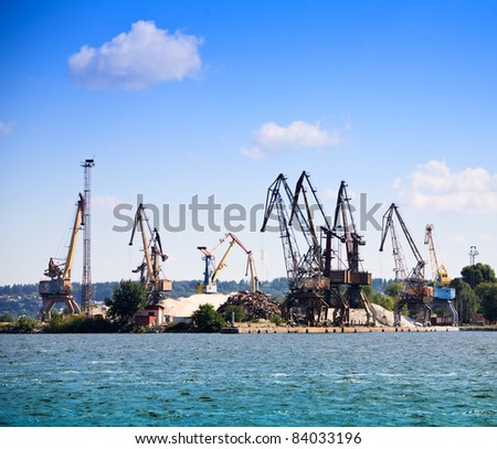 Heavy machinery in river port