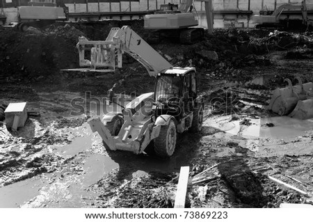 heavy machinery working at construction site - stock photo