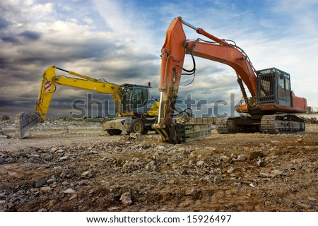 Heavy machines in a construction site ready to work. - stock photo