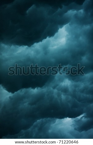 heavy massive stormy clouds with no sunlight - stock photo