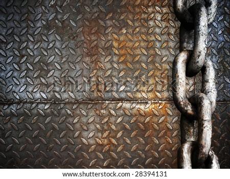 heavy metal chain on metal plate - stock photo